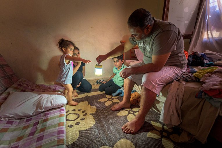 Rahim brings light to the room where his children sleep. Hope, like light, has once again brightened their home in Beirut. When the sun goes down, something as simple as a light source can help families carry on.