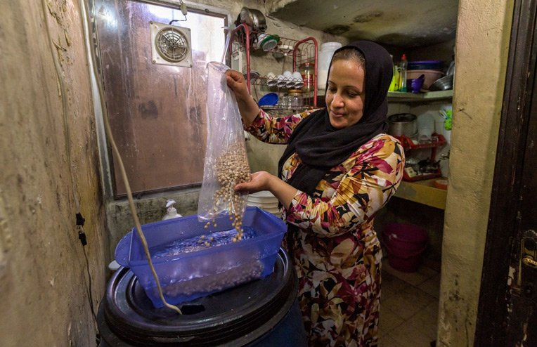 Nazia prepares a meal for her family. Working with church partners, we provided food staples and other necessities for hurting families and residents of Beirut.