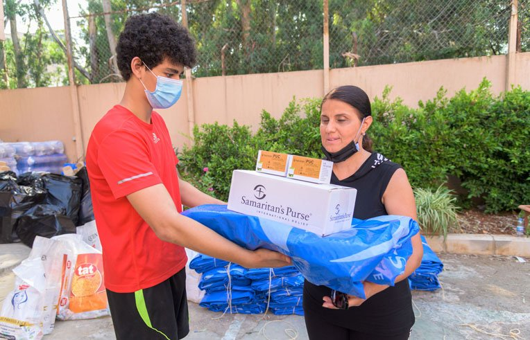 Local volunteers helped our teams distribute hygiene kits, solar lights, and heavy-duty shelter material.