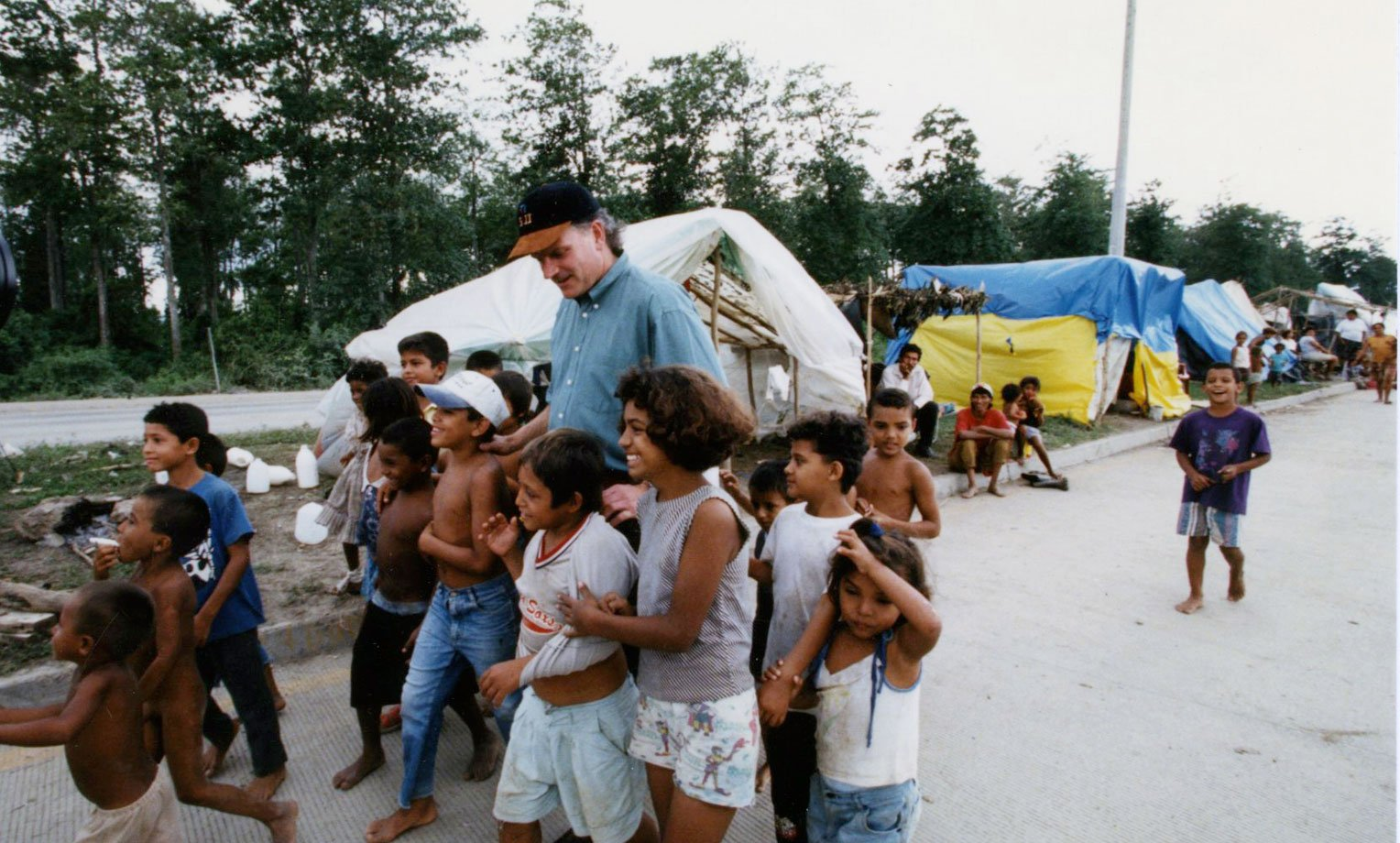 1998: Franklin Graham encourages some of the children who suffered through Hurricane Mitch.