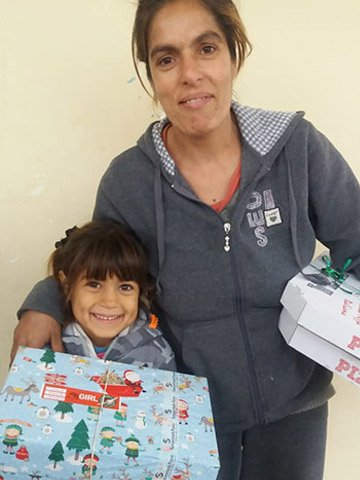 little girl and mother with shoebox