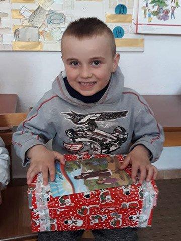 boy with shoebox