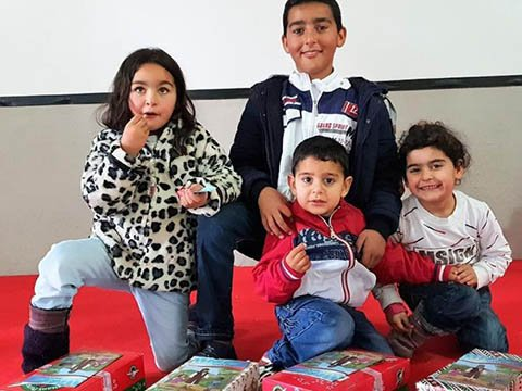 Family with shoebox gifts
