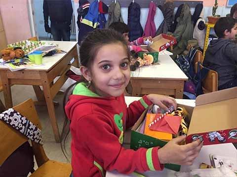 girl explores shoebox gift