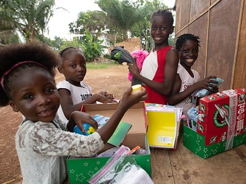 group of girls explore shoebox gifts