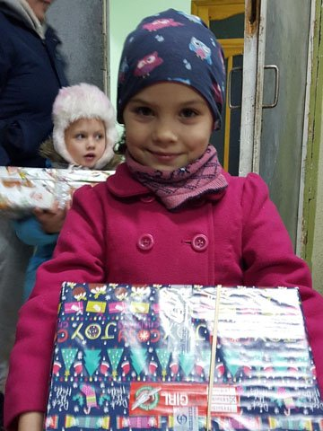 girl smiles with shoebox gift
