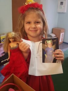 little girl with note and photo from her shoebox