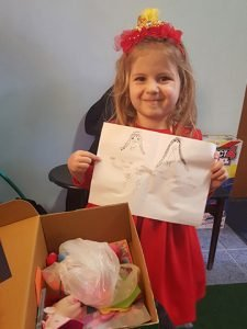 little girl with note from her shoebox