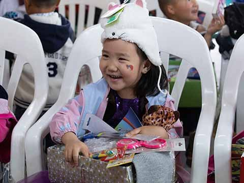 young girl wearing hat and smiling