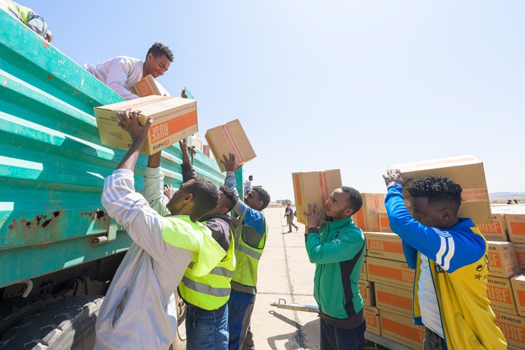 Our teams and local partners prepare to deliver emergency food to suffering communities in Ethiopia's Tigray region.