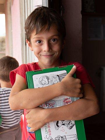 Boy in Georgia hugs shoebox gift
