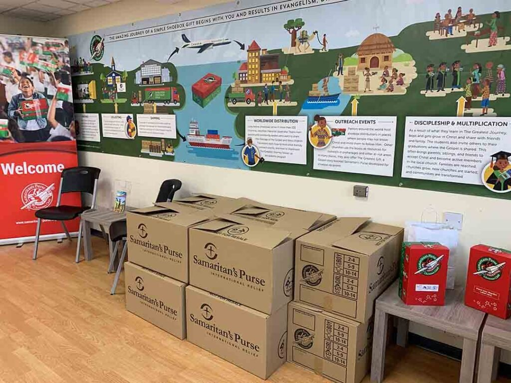 Room with 100 shoebox gifts packed in cartons