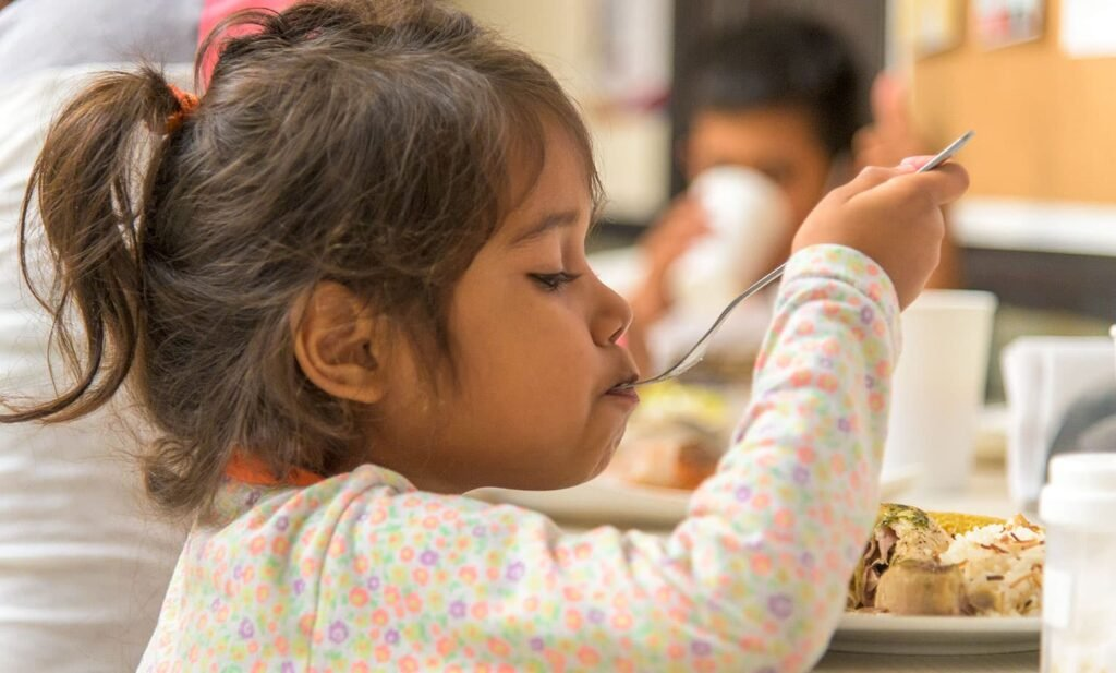 Maria's daughter has a hearty meal at our shelter in Bucaramanga.