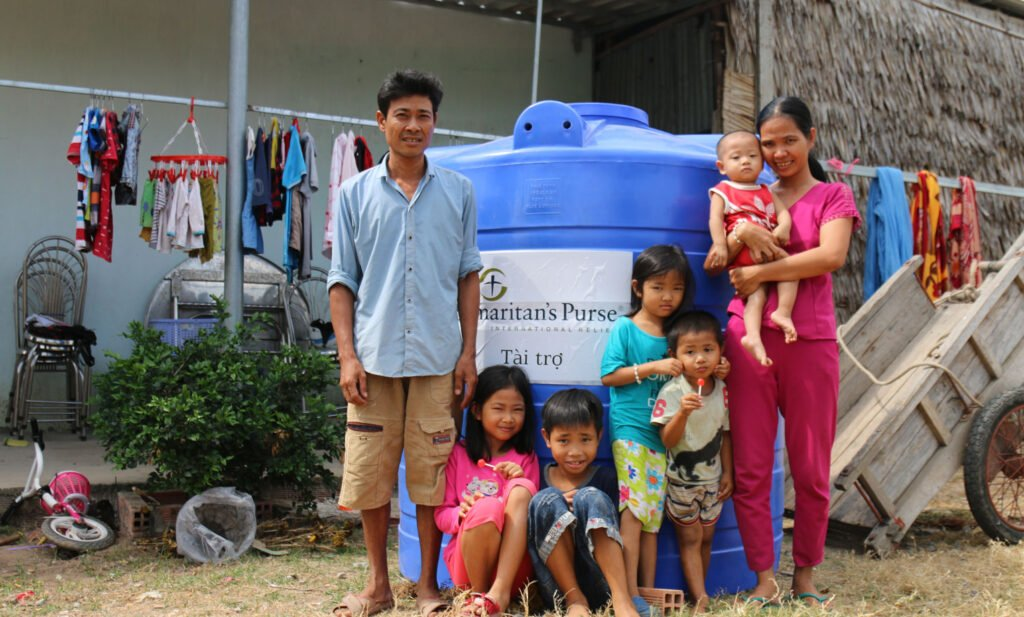 Families in Vietnam receive water storage containers to help them make it through drought season.