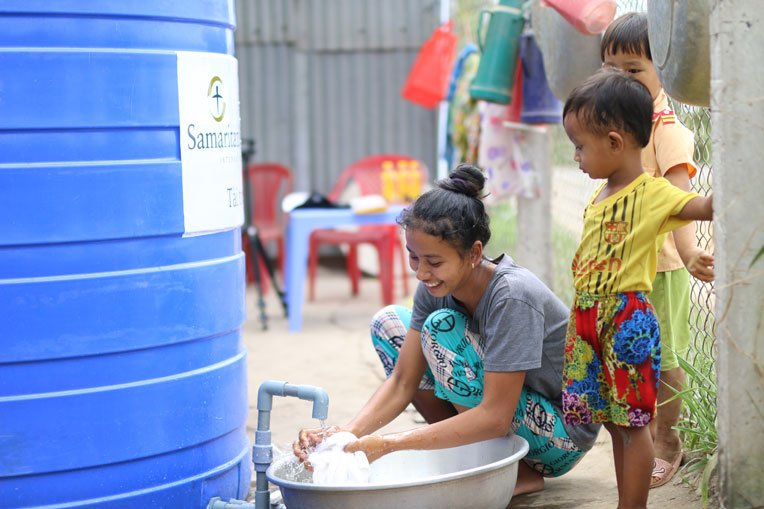Large capacity water tanks are allowing families to store water during the dry season.