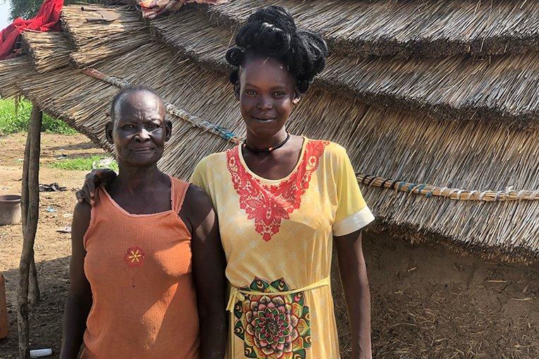 Aguek, left, is now a believer in Jesus Christ.
