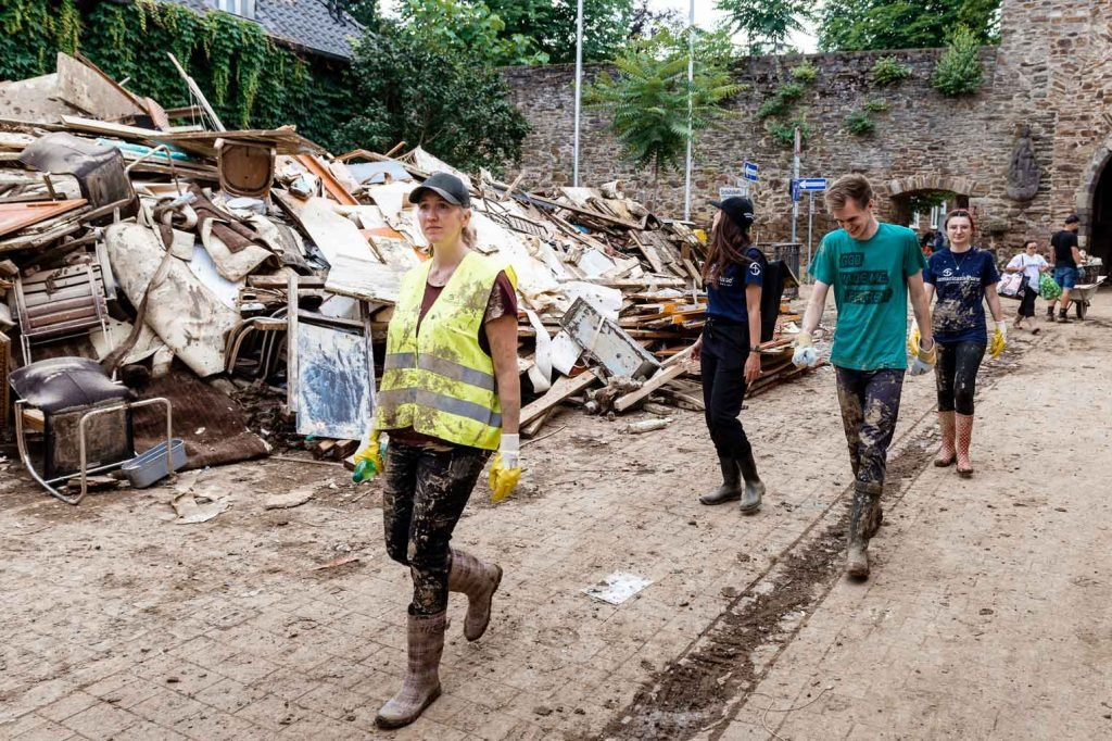 While debris piles up on the streets of Ahrweiler, Christian and Esther Giller (right) and other volunteers are there to share the hope of Jesus Christ.