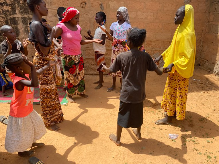 Families celebrate upon receiving food staples and cooking supplies after arriving in Niamey, Niger, with nothing.
