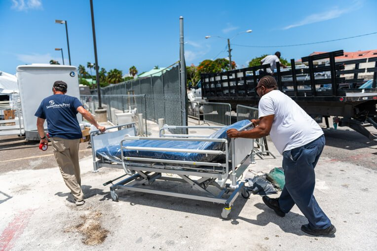 The existing facility had reached its capacity before our DART returned with new beds and tents.